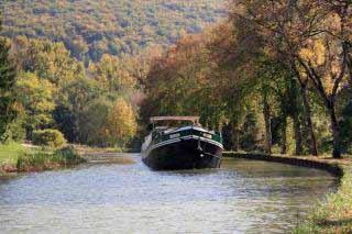 Saroche barge navigating on the Burgundy Canal near Dijon