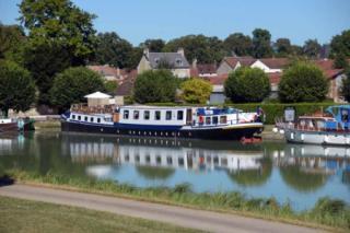 La Belle Epoque moored in a village
