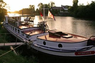 Nymphea hotel barge moored on the river