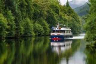 The boat cruises through the Glens & calm waters